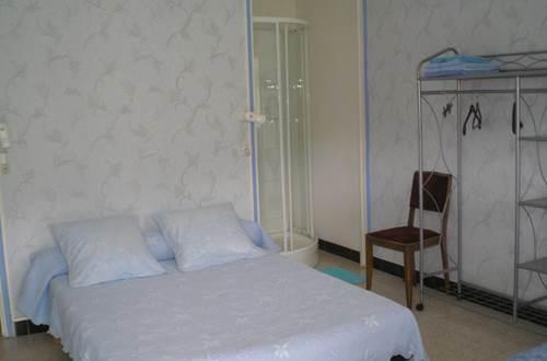 Hôtel LES QUATRE SAISONS Chambre bleue ©